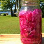 infused rose oil in jar